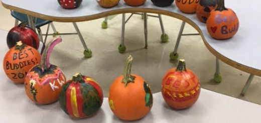 Best Buddies members painted pumpkins at a recent meeting.